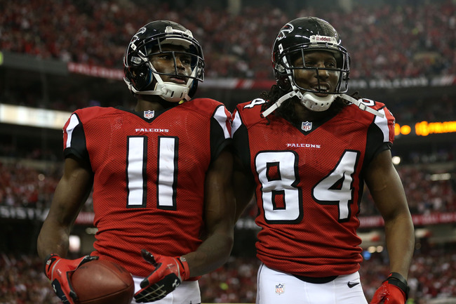 ATLANTA, GA - JANUARY 20:  Wide receiver Julio Jones #11 and wide receiver Roddy White #84 of the Atlanta Falcons celebrate after Jones catches a 20-yard touchdown catch in the second quarter against the San Francisco 49ers in the NFC Championship game at