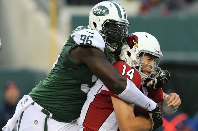 EAST RUTHERFORD, NJ - DECEMBER 02:  Ryan Lindley #14 of the Arizona Cardinals is sacked by  Muhammad Wilkerson #96 of the New York Jets on December 2, 2012 at MetLife Stadium in East Rutherford, New Jersey. The New York Jets defeated the Arizona Cardinals