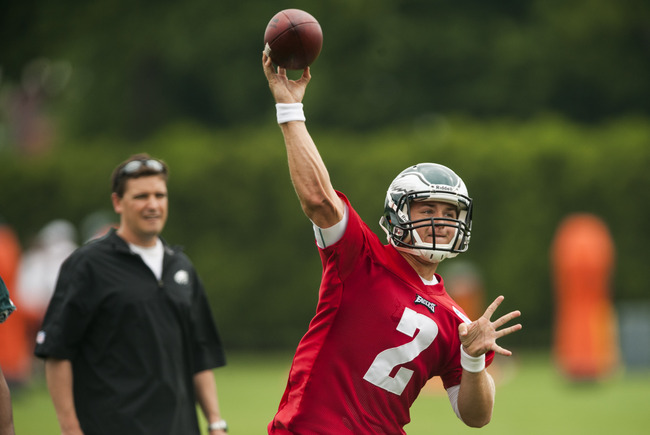May 20, 2013; Philadelphia, PA, USA; Philadelphia Eagles fourth round draft pick quarterback Matt Barkley (2) passes the ball as quarterbacks coach Bill Lazor looks on during organized team activities at the NovaCare Complex. Mandatory Credit: Howard Smit