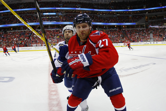 Apr 7, 2013; Washington, DC, USA; Tampa Bay Lightning right wing Martin St. Louis (26) checks Washington Capitals defenseman Karl Alzner (27) in the second period at Verizon Center. The Capitals won 4-2. Mandatory Credit: Geoff Burke-USA TODAY Sports