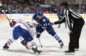 Montreal Canadien Jeff Halpern takes a faceoff against Toronto Maple Leaf Nazem Kadri.