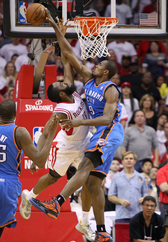 Apr 27, 2013; Houston, TX, USA; Oklahoma City Thunder power forward Serge Ibaka (9) attempts to block a shot by Houston Rockets shooting guard James Harden (13) during the fourth quarter of game three of the first round of the 2013 NBA playoffs at the Toy