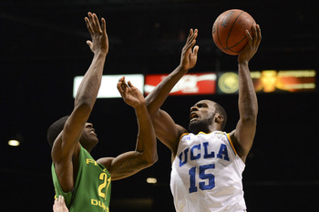 March 16, 2013; Las Vegas, NV, USA; UCLA Bruins guard/forward Shabazz Muhammad (15) shoots against Oregon Ducks guard Damyean Dotson (21) during the second half of the championship game of the Pac 12 tournament at the MGM Grand Garden Arena. Oregon defeat