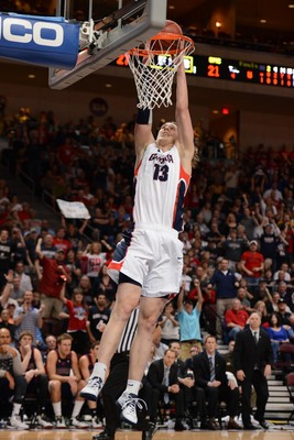 March 11, 2013; Las Vegas, NV, USA; Gonzaga Bulldogs forward Kelly Olynyk (13) dunks against the Saint Mary's Gaels during the first half in the finals of the West Coast Conference tournament at Orleans Arena. Mandatory Credit: Kyle Terada-USA TODAY Sport