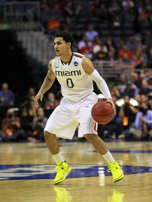 Mar 28, 2013; Washington, D.C., USA; Miami Hurricanes guard Shane Larkin (0) dribbles in the first half against the Marquette Golden Eagles during the semifinals of the East regional of the 2013 NCAA tournament at the Verizon Center. Mandatory Credit: Geo