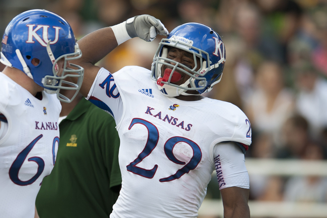 WACO, TX - NOVEMBER 3: James Sims #29 of the University of Kansas Jayhawks celebrates a touchdown against the Baylor University Bears on November 3, 2012 at Floyd Casey Stadium in Waco, Texas.  (Photo by Cooper Neill/Getty Images)