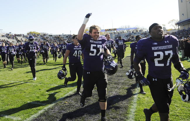 EVANSTON IL- OCTOBER 27: The Northwestern Wildcats leave the field victorious against the Iowa Hawkeyes on October 27, 2012 at Ryan Field in Evanston, Illinois. The Northwestern Wildcats defeated the Iowa Hawkeyes 28-17. (Photo by David Banks/Getty Images