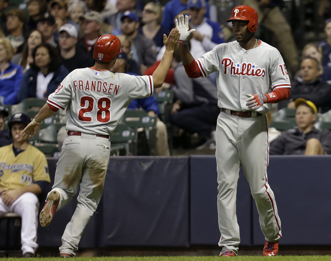 MILWAUKEE, WI - JUNE 08: Kevin Frandsen #28 of the Philadelphia Phillies celebrates with John Mayberry #15 after reaching on a double hit by Domonic Brown in the top of the eighth inning against the Milwaukee Brewers at Miller Park on June 08, 2013 in Mil