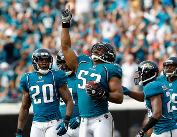 JACKSONVILLE, FL - SEPTEMBER 12:  Daryl Smith #52 of the Jacksonville Jaguars celebrates after making an interception during the NFL season opener game against the Denver Broncos at EverBank Field on September 12, 2010 in Jacksonville, Florida.  (Photo by
