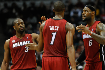 Mar 15, 2013; Milwaukee, WI, USA;   Miami Heat forward LeBron James (6) reacts with center Chris Bosh (1) and guard Dwyane Wade (3) after a Heat basket during the game against the Milwaukee Bucks at the Bradley Center. The Heat beat the Bucks 107-94. Mand