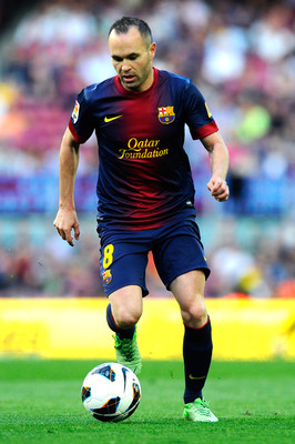 BARCELONA, SPAIN - JUNE 01:  Andres Iniesta of FC Barcelona runs with the ball during the La Liga match between FC Barcelona and Malaga CF at Camp Nou on June 1, 2013 in Barcelona, Spain.  (Photo by David Ramos/Getty Images)