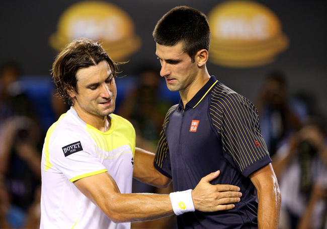 MELBOURNE, AUSTRALIA - JANUARY 24:  Novak Djokovic of Serbia shakes hands with David Ferrer of Spain after Djokovic won their Semifinal match against during day eleven of the 2013 Australian Open at Melbourne Park on January 24, 2013 in Melbourne, Austral