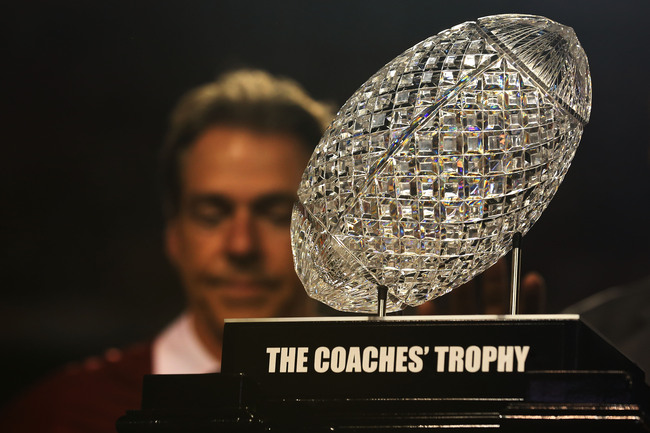 MIAMI GARDENS, FL - JANUARY 07:  Head coach Nick Saban of the Alabama Crimson Tide waits to receive the NCS Coach's Trophy after defeating the Notre Dame Fighting Irish in the 2013 Discover BCS National Championship game at Sun Life Stadium on January 7,