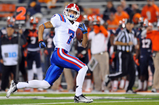 Sep 22, 2012; Champaign, IL, USA; Louisiana Tech Bulldogs wide receiver Myles White (7) runs after a reception for a touchdown during the fourth quarter against the Illinois Fighting Illini at Memorial Stadium. Mandatory Credit: Bradley Leeb-USA TODAY Spo