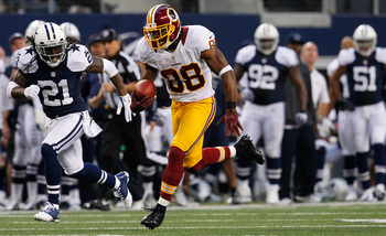 ARLINGTON, TX - NOVEMBER 22:  Pierre Garcon #88 of the Washington Redskins carries the ball to score a touchdown against Mike Jenkins #21 of the Dallas Cowboys on Thanksgiving Day at Cowboys Stadium on November 22, 2012 in Arlington, Texas.  (Photo by Tom