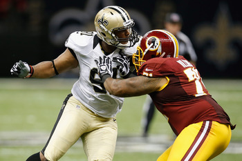 NEW ORLEANS, LA - SEPTEMBER 09:    Will Smith #91 of the New Orleans Saints tries to get around  Trent Williams #71 of the Washington Redskins during the season opener at Mercedes-Benz Superdome on September 9, 2012 in New Orleans, Louisiana.  The Redskin