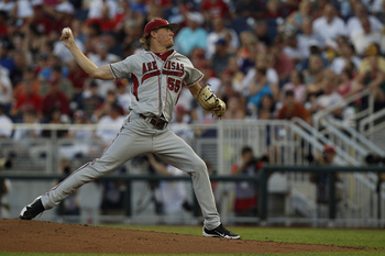 June 18, 2012; Omaha, NE, USA; Arkansas Razorbacks pitcher Ryne Stanek (55) throws against the South Carolina Gamecocks during the second inning of game eight of the 2012 College World Series at TD Ameritrade Park. Mandatory Credit: Bruce Thorson-USA TODA