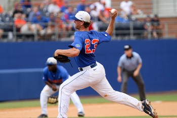 June 10, 2012; Gainesville, FL, USA; Florida Gators pitcher Jonathon Crawford delivers a pitch during game two of the Gainesville super regional at McKethan Stadium.  Mandatory Credit: Rob Foldy-USA TODAY Sports