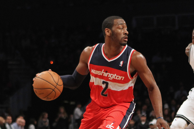 NEW YORK, NY - APRIL 15:  John Wall #2 dribbles the ball against the Brooklyn Nets at the Barclays Center on April 15, 2013 in New York City. The Nets defeated the Washington Wizards 106-101. NOTE TO USER: User expressly acknowledges and agrees that, by d