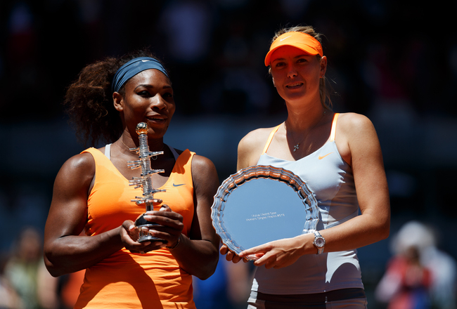 MADRID, SPAIN - MAY 12:  Serena Williams of the US and runner up  Maria Sharapova of Russia pose with their trophies after winning the final match on day nine of the Mutua Madrid Open tennis tournament at the Caja Magica  on May 12, 2013 in Madrid, Spain.