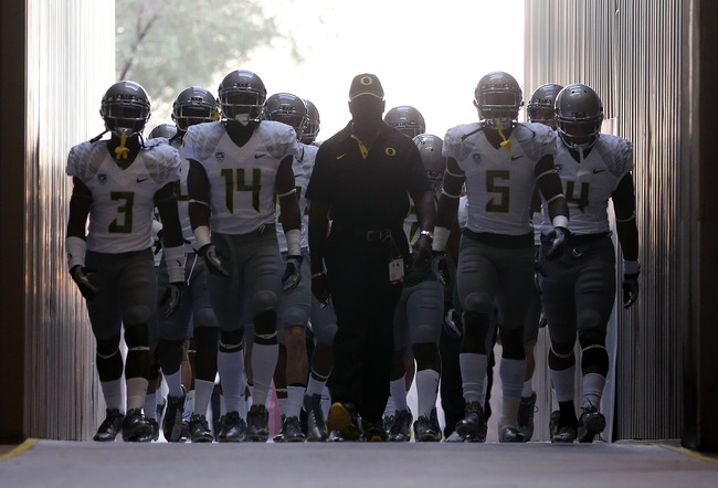 TEMPE, AZ - OCTOBER 18:  (L-R) Dior Mathis #3, Ifo Ekpre-Olomu #14, Issac Dixon #5 and Erick Dargan #4 of the Oregon Ducks walk out onto the field before the college football game against the Arizona State Sun Devils at Sun Devil Stadium on October 18, 20