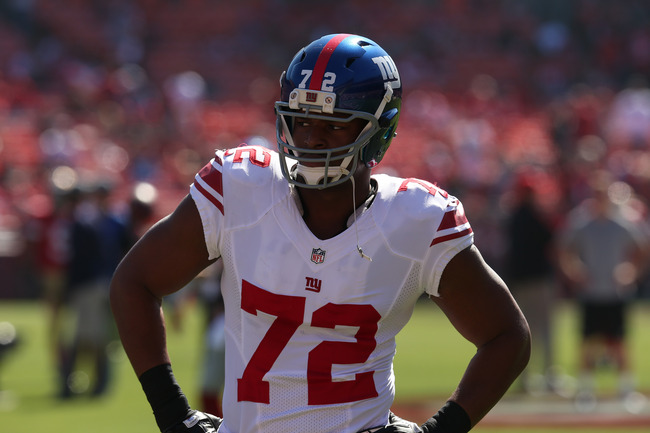 SAN FRANCISCO, CA - OCTOBER 14:  Defensive end Osi Umenyiora #72 of the New York Giants warms up for the game with the San Francisco 49ers at Candlestick Park on October 14, 2012 in San Francisco, California.  (Photo by Stephen Dunn/Getty Images)