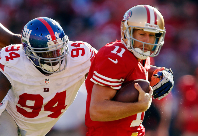 SAN FRANCISCO, CA - OCTOBER 14:  Linebacker Mathias Kiwanuka #94 of the New York Giants rushes and sacks quarterback Alex Smith #11 of the San Francisco 49ers in the fourth quarter on October 14, 2012 at Candlestick Park in San Francisco, California.  The
