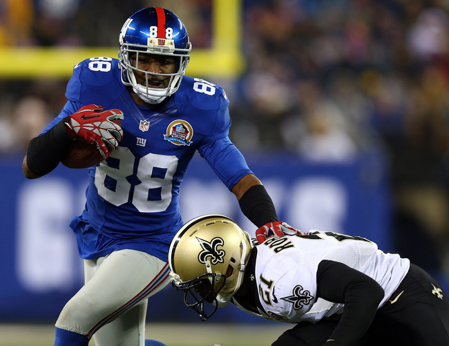 EAST RUTHERFORD, NJ - DECEMBER 09:  Hakeem Nicks #88 of the New York Giants carries the ball as  Patrick Robinson #21 of the New Orleans Saints defends on December 9, 2012 at MetLife Stadium in East Rutherford, New Jersey.  (Photo by Elsa/Getty Images)