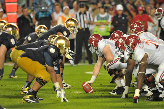 Jan 7, 2013; Miami, FL, USA; Alabama Crimson Tide offensive linesman Barrett Jones (75) prepares to snap the ball at the line of scrimmage against the Notre Dame Fighting Irish during the second half of the 2013 BCS Championship game at Sun Life Stadium.