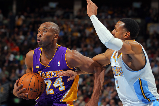 DENVER, CO - FEBRUARY 25:  Kobe Bryant #24 of the Los Angeles Lakers drives to the basket between Anthony Randolph #15 of the Denver Nuggets and Andre Iguodala #9 of the Denver Nuggets at the Pepsi Center on February 25, 2013 in Denver, Colorado. NOTE TO