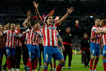 MADRID, SPAIN - MAY 17:  Radamel Falcao of Atletico de Madrid celebrates winning the match with teammates after finishing the Copa del Rey Final match between Real Madrid CF and Club Atletico de Madrid at Estadio Santiago Bernabeu on May 17, 2013 in Madri