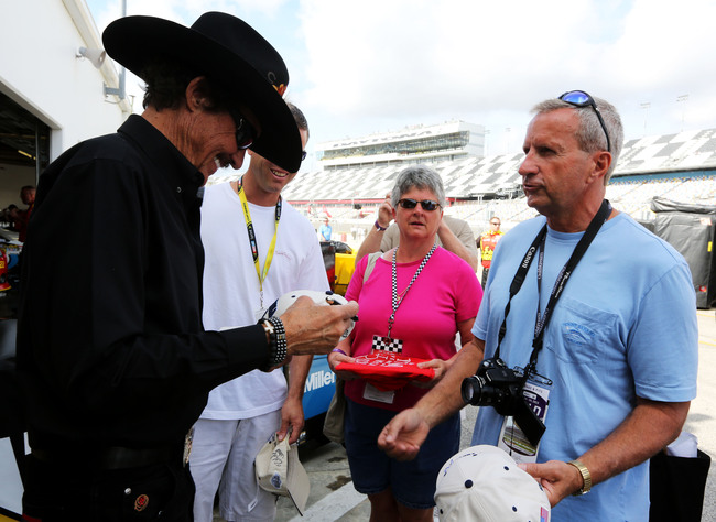 DAYTONA BEACH, FL - FEBRUARY 22: NASCAR Hall of Famer Richard Petty signs autographs  during practice for the NASCAR Sprint Cup Series Daytona 500 at Daytona International Speedway on February 22, 2013 in Daytona Beach, Florida.  (Photo by Jerry Markland/