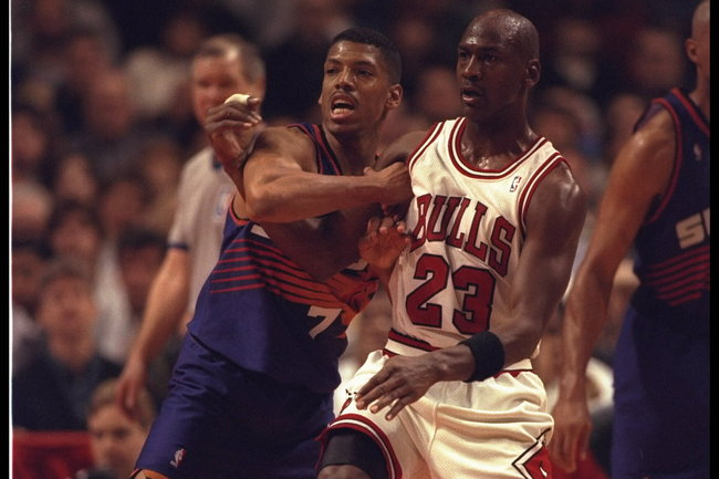 28 Jan 1996:  Guard Michael Jordan #23 of the Chicago Bulls and guard Kevin Johnson #7 of the Phoenix Suns battle for position at the United Center in Chicago, Illinois.  The Bulls defeated the Suns 93-82.  Mandatory Credit:  Jonathan Daniel/Allsport