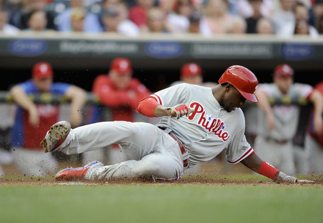 MINNEAPOLIS, MN - JUNE 11: John Mayberry Jr. #15 of the Philadelphia Phillies slides into home plate safely to score a run against the Minnesota Twins during the third inning of the game on June 11, 2013 at Target Field in Minneapolis, Minnesota. (Photo b
