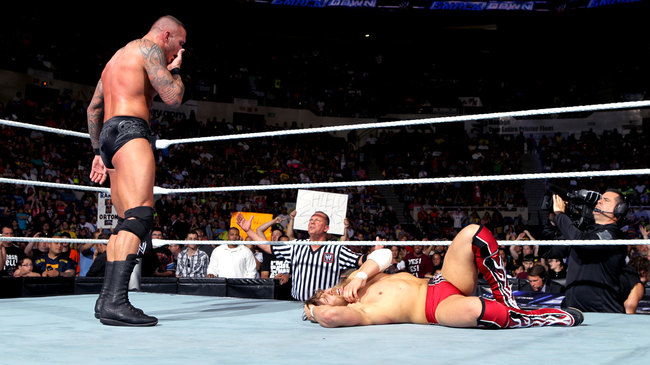 Randy Orton stand above Daniel Bryan after hitting the RKO (Image Courtesy Of WWE.com)