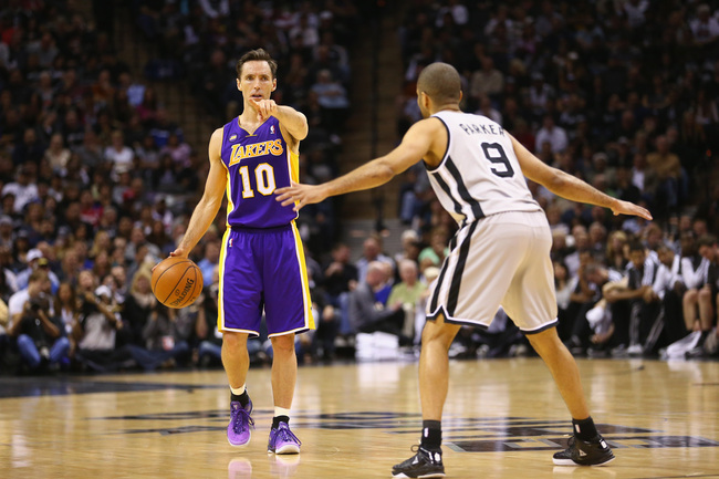 SAN ANTONIO, TX - APRIL 24:  Steve Nash #10 of the Los Angeles Lakers dribbles the ball against Tony Parker #9 of the San Antonio Spurs during Game Two of the Western Conference Quarterfinals of the 2013 NBA Playoffs at AT&T Center on April 24, 2013 in Sa