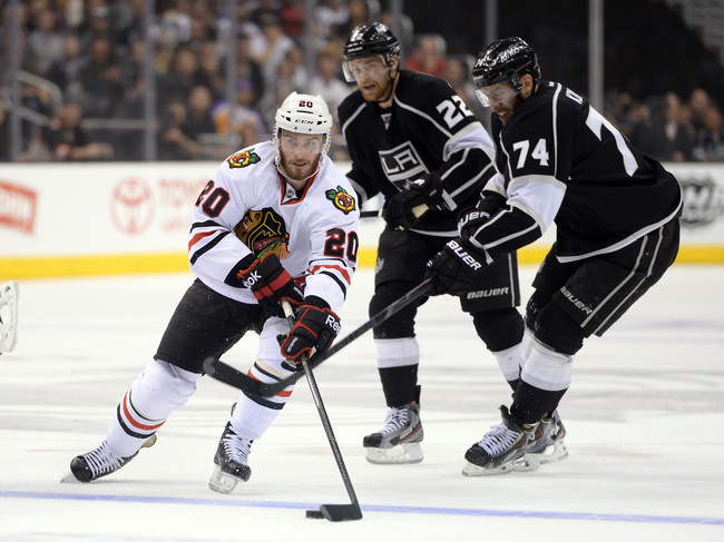 LOS ANGELES, CA - JUNE 04:  Brandon Saad #20 of the Chicago Blackhawks carries the puck over the blueline past Dwight King #74 of the Los Angeles Kings in the first period of Game Three of the Western Conference Final during the 2013 NHL Stanley Cup Playo