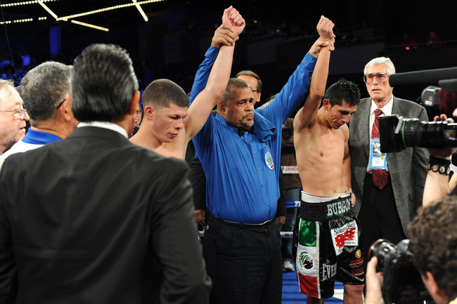 Jan 19, 2013; New York, NY, USA; Juan Carlos Burgos (right) and Rocky Martinez (left) react after their WBO World Super Featherweight Title bout at the Theatre at Madison Square Garden. The bout ended in a split draw. Mandatory Credit: Joe Camporeale-USA
