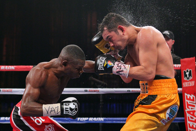 Apr 13, 2013; New York, NY, USA; Nonito Donaire (Yellow/Black Trunks) and Guillermo Rigondeaux (Green/White trunks) trade punches during their 12-round WBO/WBA Super Bantamweight title fight at Radio City Music Hall. Mandatory Credit: Ed Mulholland-USA TO