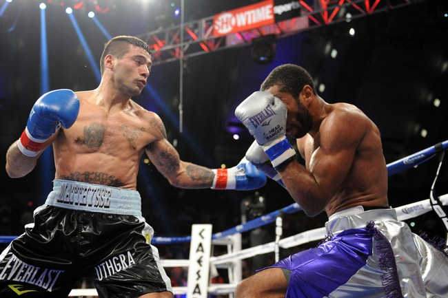 May 18, 2013; Atlantic City, NJ, USA; Lamont Peterson (silver) and Lucas Matthysse (black) box during their welterweight bout at Boardwalk Hall. Matthysse won via third round TKO. Mandatory Credit: Joe Camporeale-USA TODAY Sports