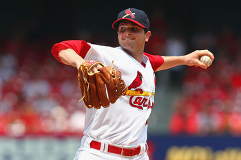 ST. LOUIS, MO - MAY 19: Starter John Gast #64 of the St. Louis Cardinals pitches against the Milwaukee Brewers at Busch Stadium on May 19, 2013 in St. Louis, Missouri.  (Photo by Dilip Vishwanat/Getty Images)