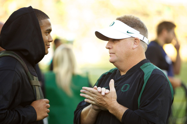 EUGENE, OR - SEPTEMBER 1: Head coach Chip Kelly of the Oregon Ducks talks with Oregon recruit Thomas Tyner from Aloha High School on September 1, 2012 at Autzen Stadium in Eugene, Oregon.  (Photo by Craig Mitchelldyer/Getty Images)