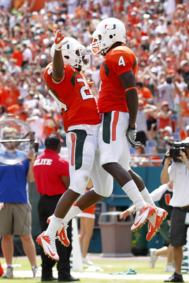 MIAMI GARDENS, FL - SEPTEMBER 29: Phillip Dorsett #4 is congratulated by Joey McNeill #24 of the Miami Hurricanes after scoring a touchdown against the North Carolina State Wolfpack on September 29, 2012 at Sun Life Stadium in Miami Gardens, Florida. (Pho