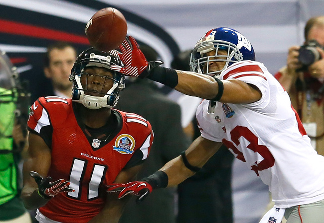 ATLANTA, GA - DECEMBER 16:  Julio Jones #11 of the Atlanta Falcons pulls in this touchdown reception against the Corey Webster #23 of the New York Giants at Georgia Dome on December 16, 2012 in Atlanta, Georgia.  (Photo by Kevin C. Cox/Getty Images)