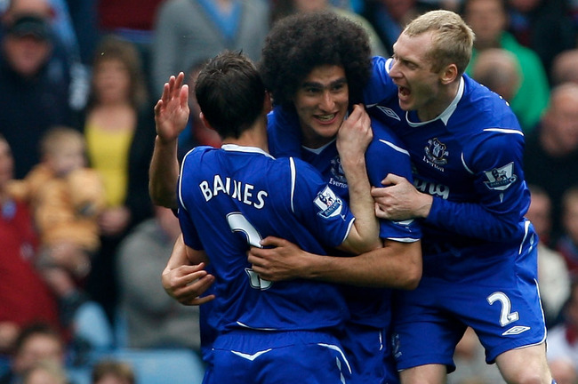 BIRMINGHAM, ENGLAND - APRIL 12:  Everton forward Marouane Fellaini celebrates with team mates Leighton Baines (l) and Tony Hibbett during the Premier League  match between Aston Villa and Everton at Villa Park on April 12, 2009 in Birmingham, England.  (P