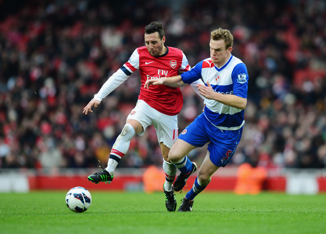 LONDON, ENGLAND - MARCH 30:  Santi Cazorla of Arsenal battles with Alex Pearce of Reading during the Barclays Premier League match between Arsenal and Reading at Emirates Stadium on March 30, 2013 in London, England.  (Photo by Jamie McDonald/Getty Images