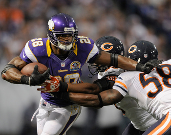 MINNEAPOLIS, MN - DECEMBER 9: Adrian Peterson #28 of the Minnesota Vikings carries the ball against Nick Roach #53 and Dom DeCicco #58 of the Chicago Bears during the fourth quarter of the game on December 9, 2012 at Mall of America Field at the Hubert H.
