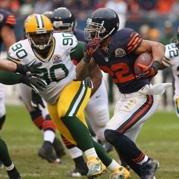 CHICAGO, IL - DECEMBER 16: Matt Forte #22 of the Chicago Bears is chased by B.J. Raji #90 of the Green Bay Packers at Soldier Field on December 16, 2012 in Chicago, Illinois. The Packers defeated the Bears 21-13. (Photo by Jonathan Daniel/Getty Images)