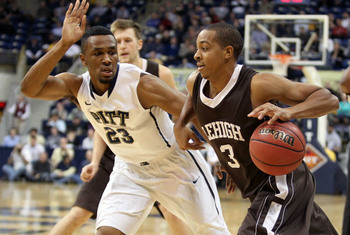 November 13, 2012; Pittsburgh, PA, USA; Lehigh Mountain Hawks guard C.J. McCollum (3) drives with the ball against Pittsburgh Panthers guard/forward Trey Zeigler (23) during the second half at the Petersen Events Center. The Pittsburgh Panthers won 78-53.
