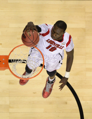 Apr 8, 2013; Atlanta, GA, USA; Louisville Cardinals center Gorgui Dieng (10) dunks the ball during the first half of the championship game in the 2013 NCAA mens Final Four at the Georgia Dome.  Mandatory Credit: Bob Donnan-USA TODAY Sports